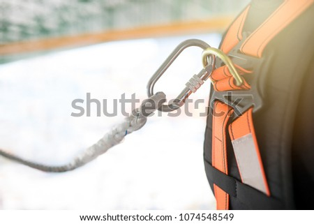 Industrial Worker with safety protective equipment loop in his back #1074548549
