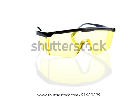 Industrial yellow Safety Shooting Glasses on white with reflections below