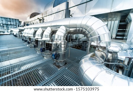 Industrial Zone. Industrial ventilation pipes and valves. (Air conditioning system) #1575103975