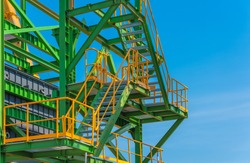 Industrial zone of stair steel,green structure and blue sky.