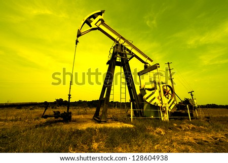 Industrial zone oil jack against sky