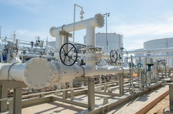 Industrial zone:Pipeline Skid Measuring Station for refinery.Oil metering station and pipeline at refinery plant.Oil and gas processing plant with pipe line valves.Outdoor pipelines in the refinery.
