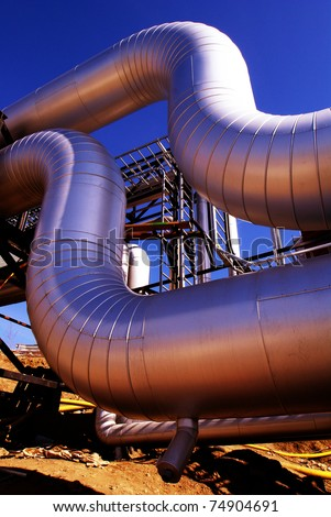 Industrial zone, Steel pipelines at sunset