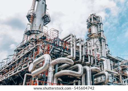Industrial zone,The equipment of oil refining,Close-up of industrial pipelines of an oil-refinery plant,Detail of oil pipeline with valves in large oil refinery. #545604742