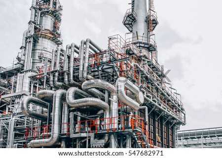 Industrial zone,The equipment of oil refining,Close-up of industrial pipelines of an oil-refinery plant,Detail of oil pipeline with valves in large oil refinery. #547682971