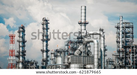 Industrial zone,The equipment of oil refining,Close-up of industrial pipelines of an oil-refinery plant,Detail of oil pipeline with valves in large oil refinery. #621879665