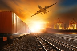 industries container trains running on railways track and commercial ship in port cargo plane flying above  use for land and vessel transport  ,logistic business