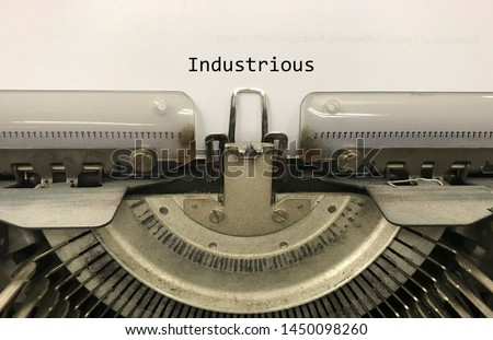 Industrious typed words on a vintage typewriter
