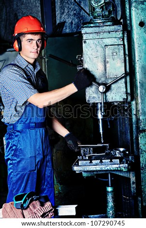 Industry: a worker at a manufacturing area.