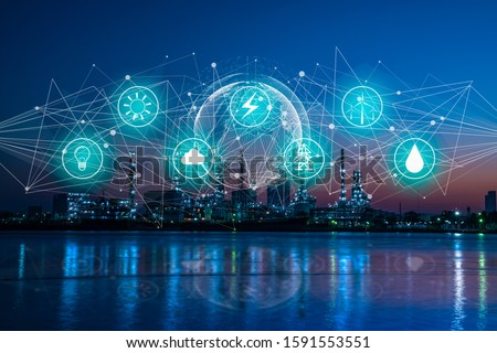 Industry 4.0 and Energy saving concept.Double exposure of energy icon and network with oil refinery industry plant background, industrial instruments in the factory and physical system icons concept.