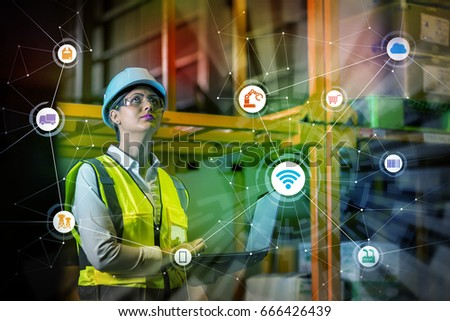 industry and Internet of Things concept. woman working in factory and wireless communication network. Industry4.0. #666426439