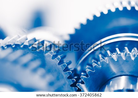 industry background with blue gear wheels