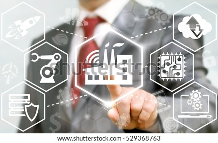 Industry 4.0 business concept. Businessman touched industrial modern factory plant icon on virtual screen on background of network manufacture sign. Manufacturing wireless computing future technology