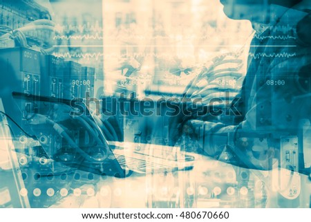 Industry 4.0 concept image. Double exposure of industrial instruments in the factory and business man using laptop computer.