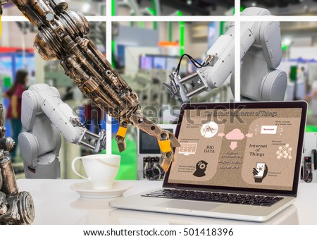 Industry 4.0 concept image. Robot arm point to the Industrial internet of things process diagram on the laptop screen and  Robot arm in the factory. #501418396