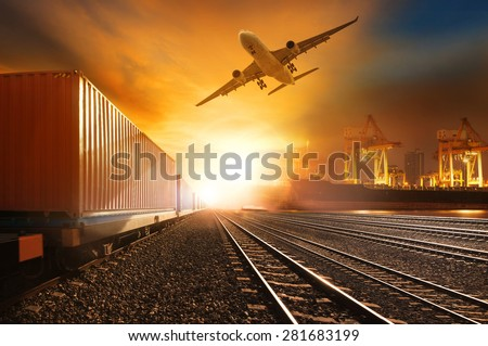industry container trains running on railways track and commercial ship in port ,plane air cargo flying above  use for land ,air ,and vessel transport industry  and logistic business