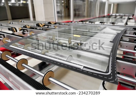 Industry detail with a rear car glass on the production line in a glass factory