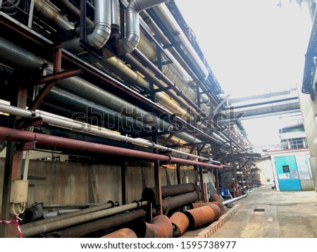 Industry Equipment Installation. Close up Industrial view at oil refinery plant form industry zone.