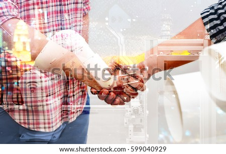 Industry 4.0 internet of things concept. Double exposure of Two Engineers man shake hands , automation wireless robot machine arm and circuit boards background in smart factory.