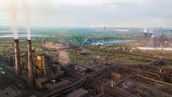 Industry metallurgical plant smoke from pipes mining ecology pollution.