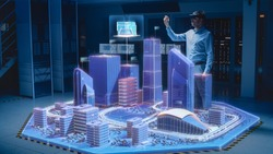 Industry 4.0: Modern Professional Architect Wearing Virtual Reality Headset Uses Gestures to Design, Manipulate Buildings for 3D City. Mixed Augmented Reality Software. VFX Special Visual Effect