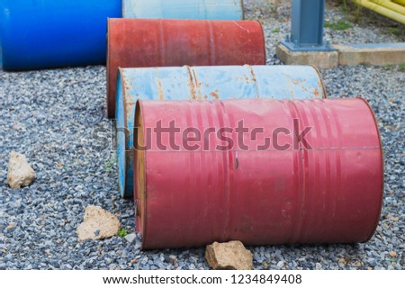 Industry oil barrels or chemical drums stacked up.chemical tank.container of  barrels of hydrocarbons.Chemical reagents.hazardous waste of red and blue tank oil. #1234849408
