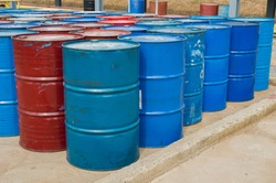 Industry oil barrels or chemical drums stacked up.Stack Of Oil barrels in plant.Oil drums waste and Chemical tank  in plant.hazardous waste of black and blue tank oil at the industrial event