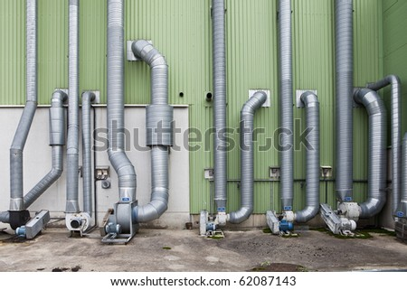 Industry pipes outside a warehouse building