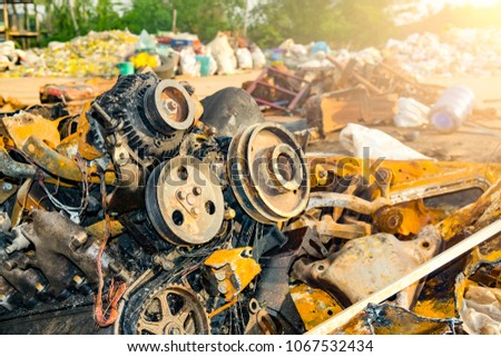 Industry recycle engine. Engine wreck from caught fire kept for recycle. Machine technician separate and classification part of iron or steel car machine wreck for easy worker or labor to recycling