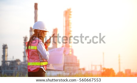 Industry Safety.  The people worker women engineer work  control at power plant energy industry manufacturing, Thailand.  Engineer Concept.