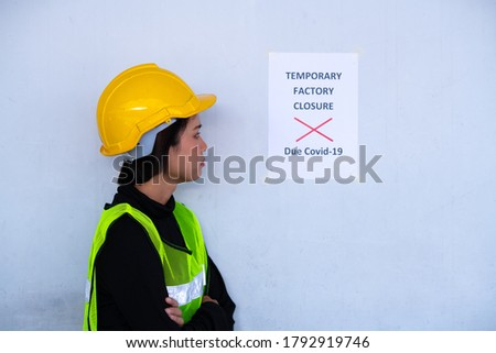 Industry worker feel serious when see factory announcement factory temporary closure because coronavirus situation business crisis.  Photo stock ©