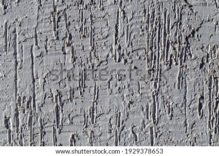 Inexpensive original finishing of facades with wet plaster. Simple textured finish of facade of building. In form of uneven scratches. Texture of gray color. Photo stock ©