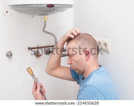 Inexperienced plumber trying to repair an electric water heater