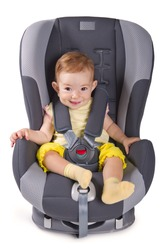 Infant baby girl sitting in a car seat, isolated on white