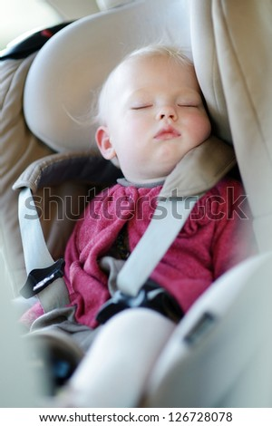 Infant baby sleeping peacefully in a car seat