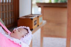 Infant being held at a shrine visit