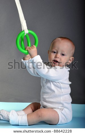 Infant boy with gymnastic rings