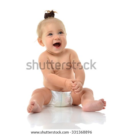 Infant child baby girl toddler sitting smiling laughing looking up isolated on a white background