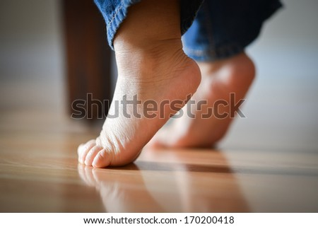 Infant Child's Feet On Tippy Toes - Innocence Concept