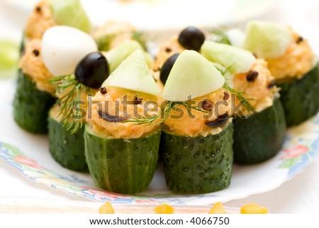 infant food - stuffed cucumbers, designed like gnomes