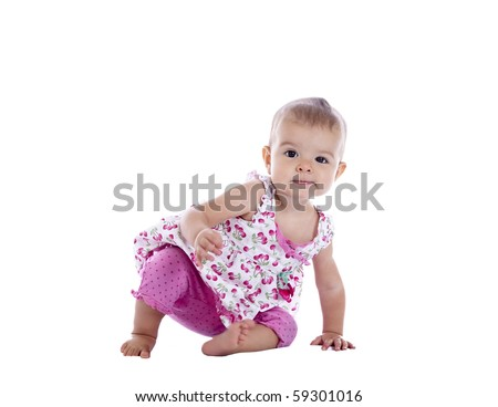 infant girl scooting on the floor, isolated with clipping path