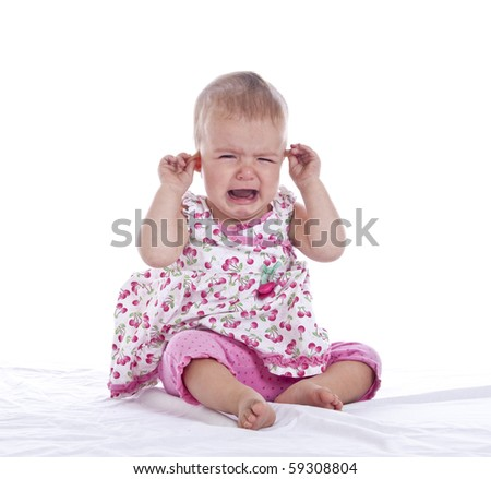 infant girl with ear ache, isolated with clipping path