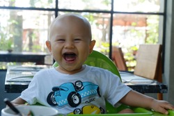 infant newborn baby smile With The Family at meal time at Home