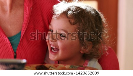 Infant toddler bursting laughing out loud, 2 year old laughs feeling happy and joy #1423652009