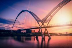 Infinity Bridge on dramatic sky at sunset in Stockton-on-Tees, UK.