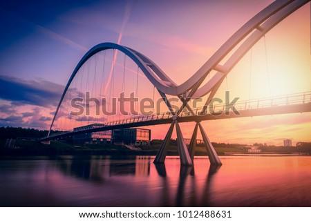 Infinity Bridge on dramatic sky at sunset in Stockton-on-Tees, UK. #1012488631