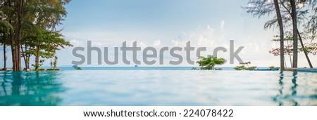 Infinity pool at tropical ocean  beach #224078422