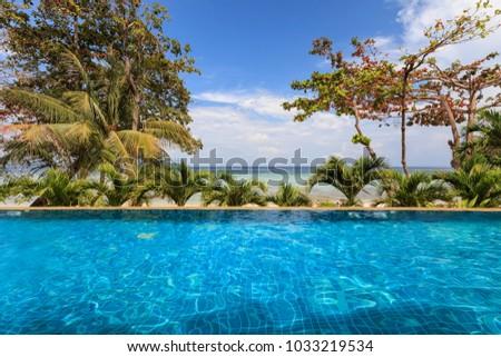 Infinity pool overlooking the beach in Phi Phi Don Island in Krabi, Thailand #1033219534
