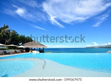 Infinity pool overlooking the sea #199567475