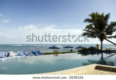 infinity swimming pool by the Caribbean sea hotel resort   Sosua Dominican Republic